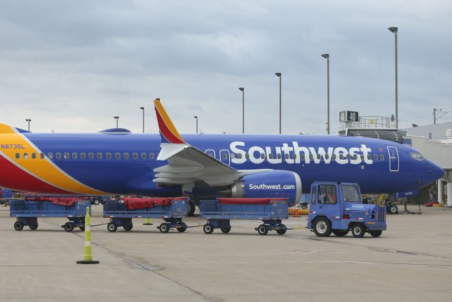 A baggage cart passes a Southwest Airlines 737 Max 8 airliner Wednesday at St. Louis-Lambert International Airport in St. Louis, Mo. Photo by Bill Greenblatt/UPI