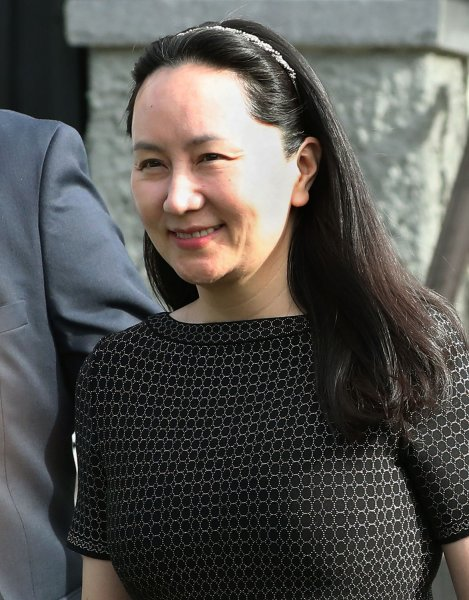Huawei CFO Meng Wanzhou wearing a GPS tracker and ankle bracelet is escorted by court-appointed security as she leaves one of her two multi-million dollar houses for BC Supreme Court in Vancouver, British Columbia (BC), May 8, 2019. Photo by Heinz Ruckemann/UPI