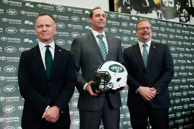 New York Jets CEO Christopher Johnson (L) said there will be no coaching change despite head coach Adam Gase (C) and the team's disappointing season. File Photo by John Angelillo/UPI