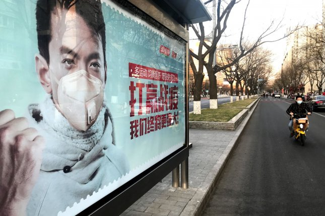 Public health warning displays, like this one pictured in Beijing on Monday, have been placed along roads and bus stops across China. Photo by Stephen Shaver/UPI