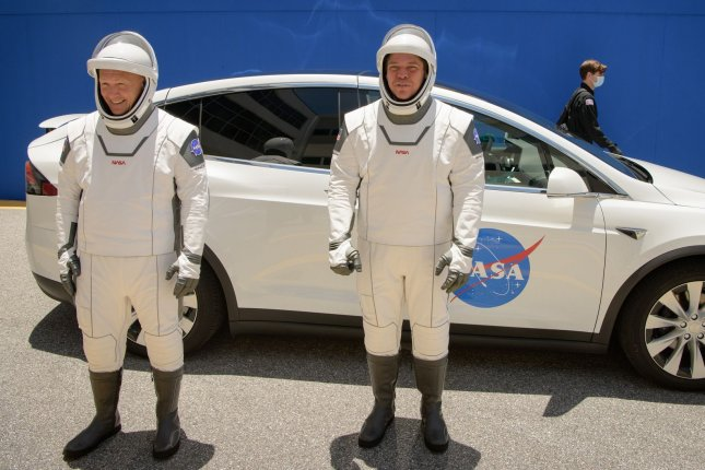 NASA astronauts Douglas Hurley (L) and Robert Behnken, wearing SpaceX spacesuits, depart Saturday for Launch Complex 39A at Kennedy Space Center during a dress rehearsal for the Demo-2 mission launch. NASA Photo by Bill Ingalls/UPI