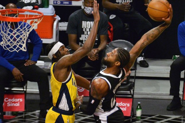 Los Angeles Clippers forward Paul George scores two of his 20 points in a win over the Indiana Pacers on Sunday in Los Angeles. Photo by Jim Ruymen/UPI