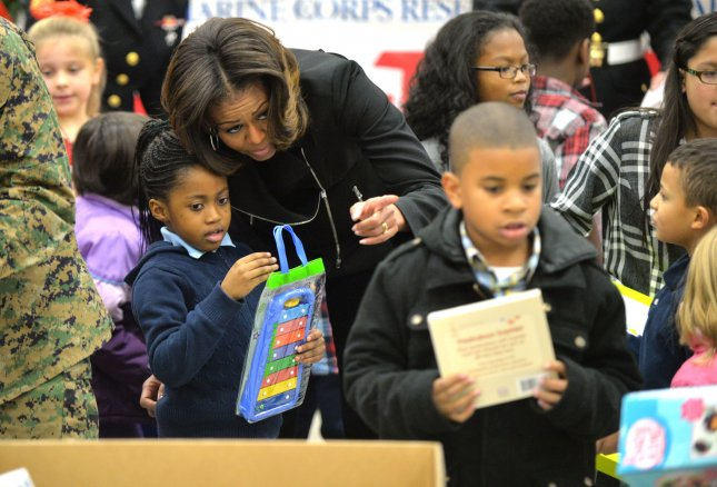 Bacteria causing infections persist on surfaces longer than thought. First Lady Michelle Obama helps children of military parents sort toy donations for Toys For Tots, during a donation event at Joint Base Anacostia-Bolling in Washington, D.C. on December 19, 2013. UPI/Kevin Dietsch
