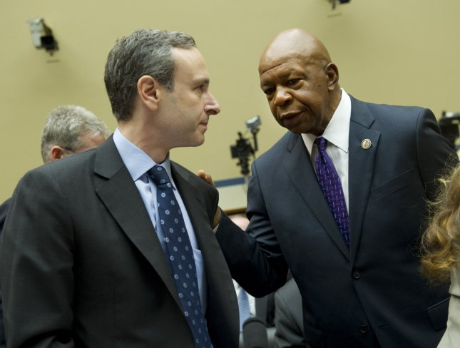 Ranking Member Rep. Elijah Cummings (D-MD) talks to Douglas Shulman, Former Internal Revenue Service (IRS) Commissioner, prior to a House Oversight and Governmental Reform Committee hearing on the IRS and it's targeting of conservative groups, on Capitol Hill on May 22, 2013 in Washington, D.C. UPI/Kevin Dietsch