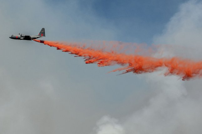 A National Guard C-130 tanker drops retardant to slow down active fire on Crocker Ridge below Pilot Peak near Yosemite National Park, California on August 28, 2013. UPI/Al Golub