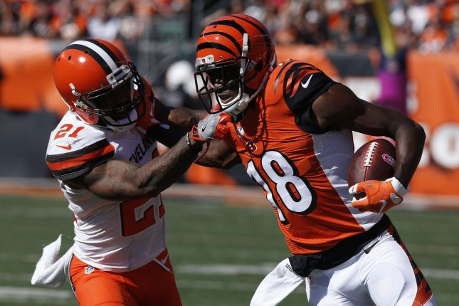 Cincinnati Bengals wide receiver A.J. Green (18) fights to break free from Cleveland Browns Jamar Taylor (21) during the first half of play at Paul Brown Stadium in Cincinnati, Ohio, October 23, 2016. Photo by John Sommers II/UPI