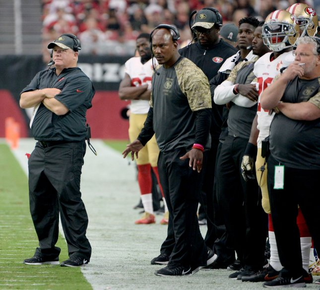 San Francisco's head coach Chip Kelly (L) watches the action in the second quarter of the 49ers-Arizona Cardinals game at University of Phoenix Stadium in Glendale, Arizona, November 13, 2016. The Cardinals defeated the 49ers 23-20. Photo by Art Foxall/UPI