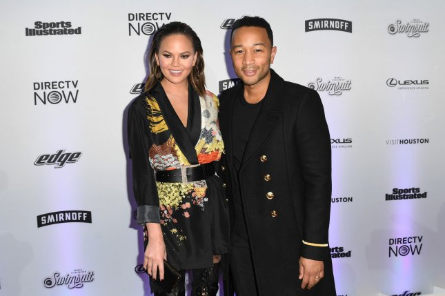 John Legend (R) and Chrissy Teigen at the Sports Illustrated swimsuit issue launch on February 16. File Photo by Andrea Hanks/UPI