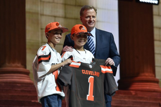 NFL commissioner Roger Goodell poses for a photo with young Browns fans after announcing Texas A&M' Myles Garrett is selected by the Cleveland Browns as the first overall pick in the 2017 NFL Draft at the NFL Draft Theater in Philadelphia, PA on April 27, 2017. Photo by Derik Hamilton/UPI