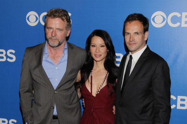 Aidan Quinn, Lucy Liu and Jonny Lee Miller will return for Season 6 of their series Elementary on CBS April 30. File Photo by John Angelillo/UPI