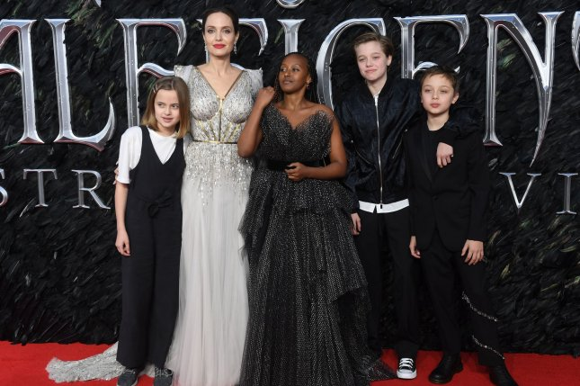 Angelina Jolie (second from left), pictured with children Vivienne, Zahara, Shiloh and Knox (from left to right), discussed her children and the importance of living freely in the December issue of Harper's Bazaar. File Photo by Rune Hellestad/UPI
