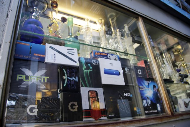 Electronic cigarettes and tobacco products are shown in the window of a smoke shop in New York City, where councilors will vote Tuesday on a measure to ban the sale of flavored vaping devices. File Photo by John Angelillo/UPI