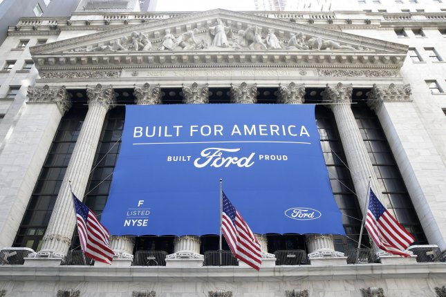 The Ford logo hangs outside at the New York Stock Exchange on Wall Street in New York City on August 17. Photo by John Angelillo/UPI