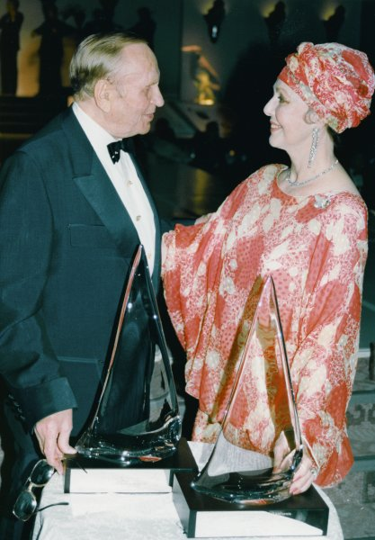 """Gene Autry and Loretta Young enjoy the moment on August 10, 1988, as they are honored at the Jewel Gala V with Lifetime Awards for their work within the arts as well as their work for the community. The event was part of a Star-studded, heavily bejeweled benefit for the USC Fine Arts Department and featured a fashion show called """"Diamonds, The Crowning Glory,"""" which featured an impressive array of jewelry from the industry leaders. (UPI Photo/handout/Alan Berliner/Files)"""