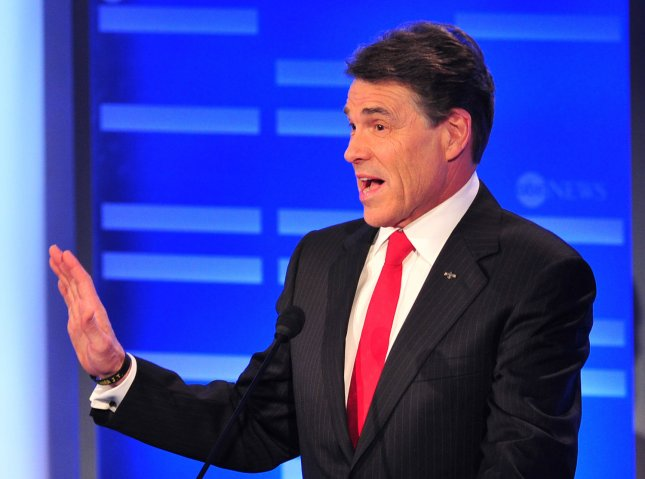 Texas Gov. Rick Perry participates in the Republican Presidential Debate on the campus of Saint Anselm College in Manchester, N.H., on Jan. 7, 2011. Perry later called a ruling against Texas's voter ID law a victory for fraud. -- UPI/Kevin Dietsch
