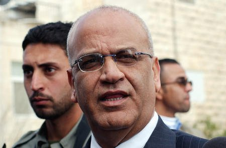 Saeb Erekat, top Palestinian spokesman, tells the press that he will not be a minister in the new Palestinian government outside Prime Minister Ahmed Qureia office in Ramallah, West Bank, February 24, 2005. (UPI File Photo/Debbie Hill)