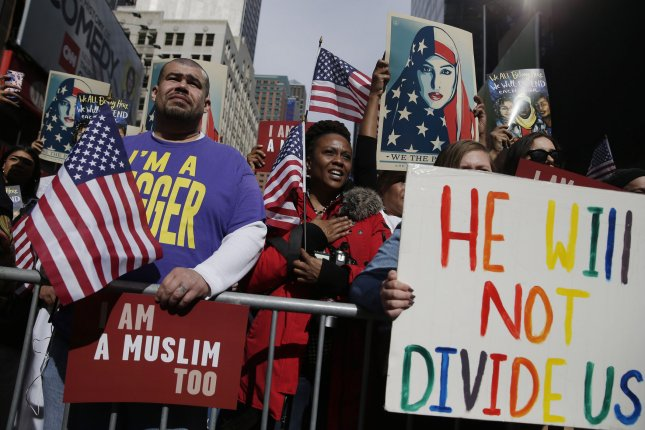 Protesters rally against the immigration policies of President Donald Trump in Times Square in New York City on Sunday. Photo by John Angelillo/UPI