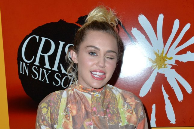 Miley Cyrus poses at The Crisis in Six Scenes premiere at The Crosby Street Hotel in New York City on September 15, 2016. Cyrus is to be a presenter at Sunday's iHeartRadio Music Awards. File Photo by Andrea Hanks/UPI