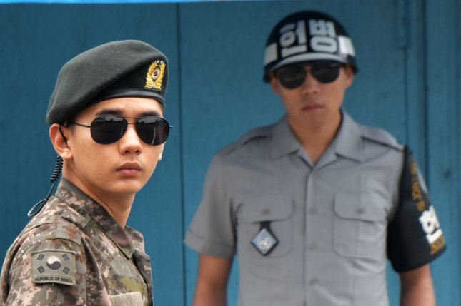 South Korean soldiers stand guard at the joint security area of Panmunjom in the demilitarized zone. South Korea has been reviewing the reopening of a line of communication with North Korea at the truce village. Photo by Keizo Mori/UPI