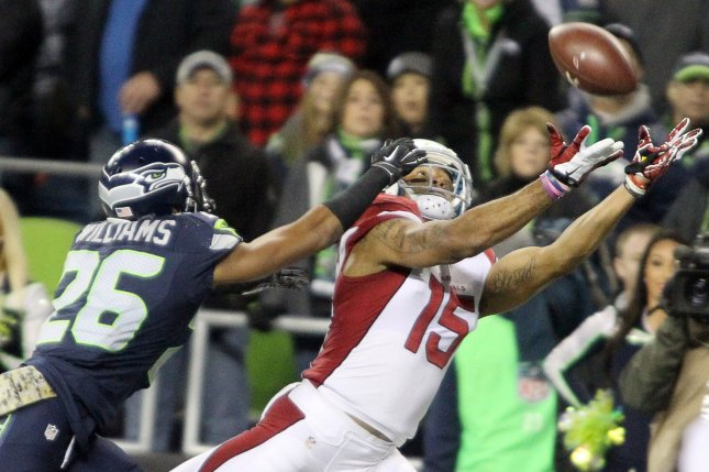 Former Arizona Cardinals wide receiver Michael Floyd catches a 27-yard touchdown pass over defending Seattle Seahawks cornerback Cary Williams at CenturyLink Field in Seattle, Washington. File photo by Jim Bryant/UPI