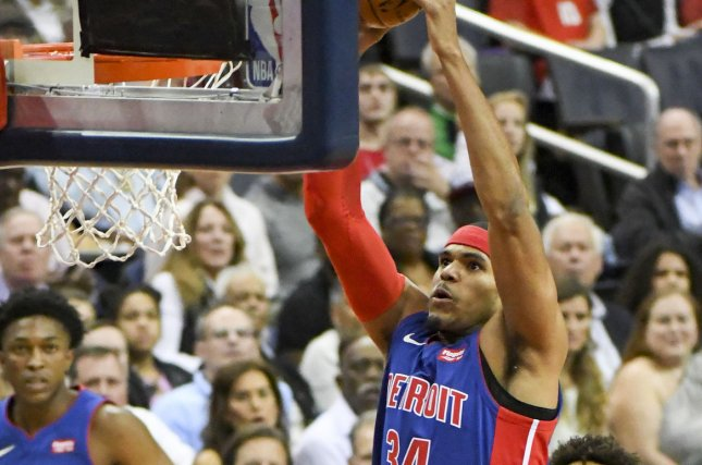 Detroit Pistons forward Tobias Harris (34) scores against Washington Wizards center Marcin Gortat (13) in the first half at the Capital One Arena in Washington, D.C. on October 20, 2017. File photo by Mark Goldman/UPI