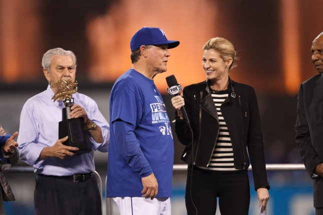 Erin Andrews (R), pictured with Ned Yost, discussed her plans for children on Tuesday's episode of Good Morning America. File Photo by Jeff Moffett/UPI