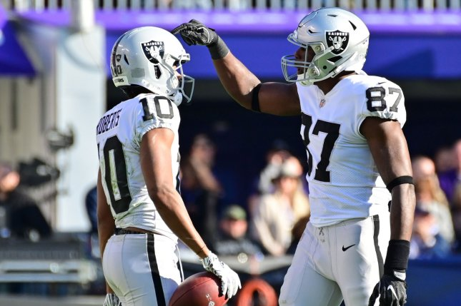 Oakland Raiders tight end Jared Cook (87) and wide receiver Seth Roberts (10) react during the first half of an NFL game against the Baltimore Ravens on November 25 at M&T Bank Stadium in Baltimore. Photo by David Tulis/UPI