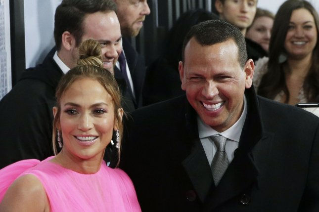Alex Rodriguez (R) and Jennifer Lopez attend the New York premiere of Second Act on Wednesday. Photo by John Angelillo/UPI