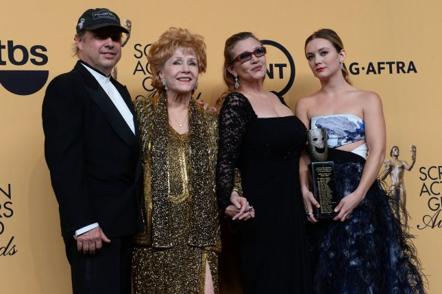 (L-R) Todd Fisher, actress Debbie Reynolds, actress Carrie Fisher and Billie Lourd pose backstage at the 21st annual SAG Awards in Los Angeles on January 25, 2015. Carrie Fisher remains hospitalized following a heart attack Friday. File Photo by Jim Ruymen/UPI