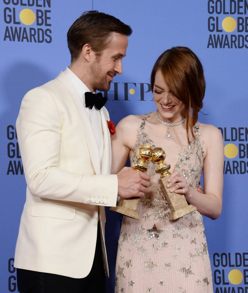Ryan Gosling and Emma Stone, winners of the awards for Best Performance by an Actor and Actress in a Motion Picture Musical or Comedy respectively for La La Land, appear backstage with their trophies during the 74th annual Golden Globe Awards at the Beverly Hilton Hotel in Beverly Hills, California on Sunday. Photo by Jim Ruymen/UPI