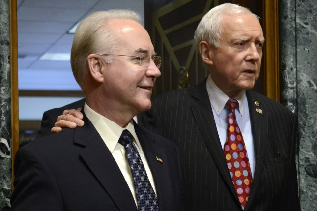 Georgia Rep. Tom Price, left, nominated to be Health and Human Services secretary, arrives with Senate Finance Committee Chairman Orrin Hatch, R-Utah, for Price's confirmation hearing in Washington, D.C., on January 24. On Wednesday, Republicans on the committee moved Price and Steven Mnuchin's Cabinet nominations forward by approving them without a Democrat being present. Jeff Sessions' nomination as attorney general was also approved by the Senate Judiciary Committee. Photo by Mike Theiler/UPI