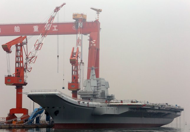 China's second aircraft carrier, currently called the 001A, is seen parked in a shipyard in the port city of Dalian in Liaoning Province, on May 4, 2017. The vessel, China's first self-built carrier, is among a wide range of research and development efforts the nation has taken on to bolster it's military capabilities in recent years. China revealed earlier this week it has started an agency similar to DARPA in the United States that will be tasked with advanced technological research. File photo by Stephen Shaver/UPI