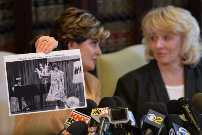 Attorney Gloria Allred (L) holds a photo of former actress Heather Kerr (R) from a television program she appeared in, adding her name to the list of women alleging sexual misconduct by Hollywood mogul Harvey Weinstein in Los Angeles on October 20. Photo by Jim Ruymen/UPI