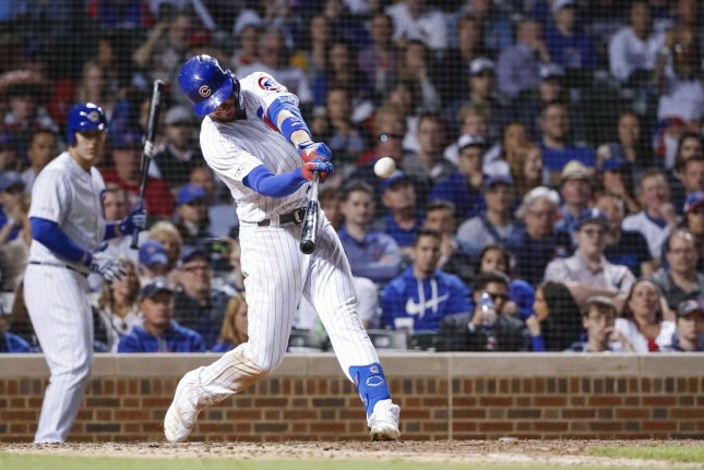 Chicago Cubs third baseman Kris Bryant hit a grand slam against the St. Louis Cardinals when his team already had a 9-2 lead against its National League Central rivals. Chicago nows tops the division after a three-game sweep of St. Louis. Photo by Kamil Krzaczynski/UPI