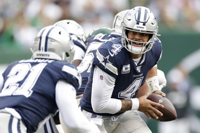 Dallas Cowboys quarterback Dak Prescott (4), who played under the franchise tag in 2020, threw for 1,856 yards with nine touchdowns and four interceptions in five games last season. File Photo by John Angelillo/UPI