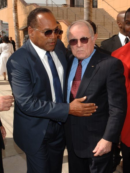 O.J. Simpson (L) greets attorney F. Lee Bailey as they leave the funeral service of Johnnie Cochran at West Angeles Cathedral in Los Angeles' Crenshaw District April 6, 2005. Bailey died Thursday. File Photo by Jim Ruymen/UPI