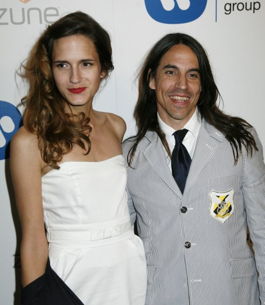 Singer Anthony Kiedis of the Red Hot Chili Peppers and guest Heather arrive for the Warner Music Group's Grammy After Party at The Cathedral in Los Angeles on February 11, 2007. (UPI Photo/David Silpa)