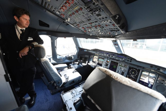 Captain Mike Blythe stands in the cockpit of British Airways' new Airbus A380 after its inaugural arrival to Washington Dulles International Airport in Dulles, Virginia, Oct., 2, 2014. The A380 is the world's largest passenger aircraft, and for the first time customers will be able to experience the service between Washington D.C. and London. File Photo by Molly Riley/UPI.