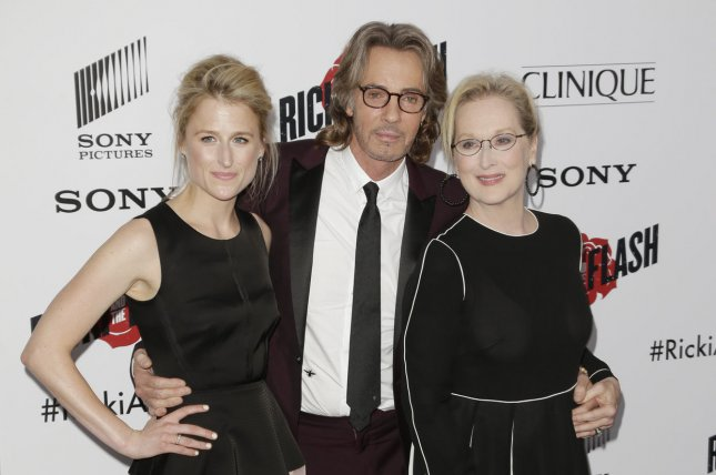 Mamie Gummer, left, and mom Meryl Streep, right, with co-star Rick Springfield at the New York premiere of 'Ricki and the Flash' on Monday. Photo by John Angelillo/UPI