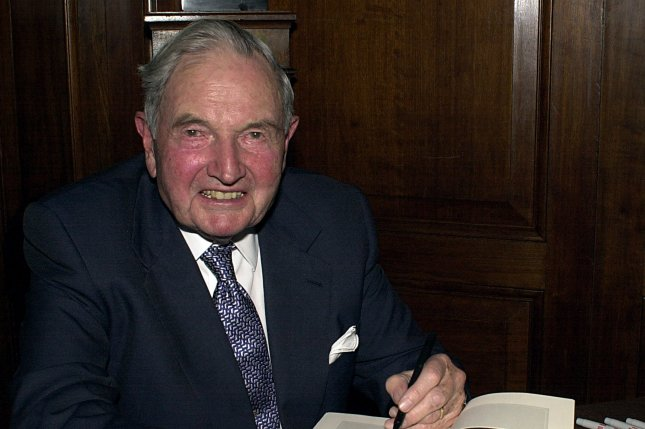 David Rockefeller, honorary chairman of the Council on Foreign Relations, autographs copies of his biography, Memoirs, during a November 4, 2002, book signing session in New York. The banker, philanthropist and presidential was the last surviving grandson of John D. Rockefeller until his death Monday. File Photo by Ezio Petersen/UPI