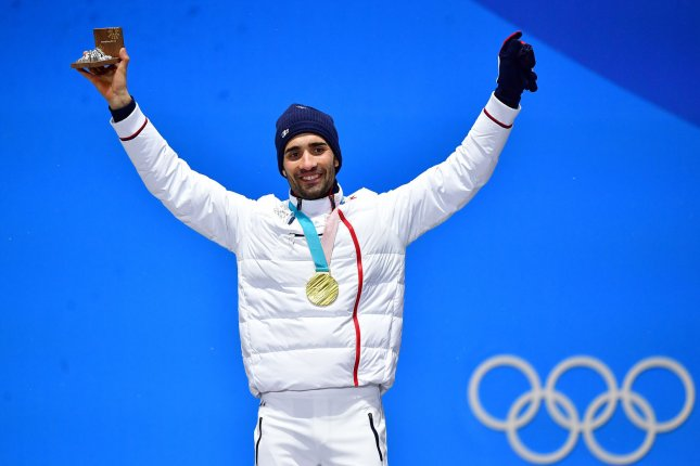 Fourcade leads French mixed biathlon team to victory