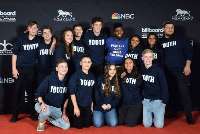 Shawn Mendes, center left, and Khalid, center right, appear backstage with Marjory Stoneman Douglas Student Choir during the 2018 Billboard Music Awards at MGM Grand Garden Arena on Sunday in Las Vegas. Photo by Jim Ruymen/UPI