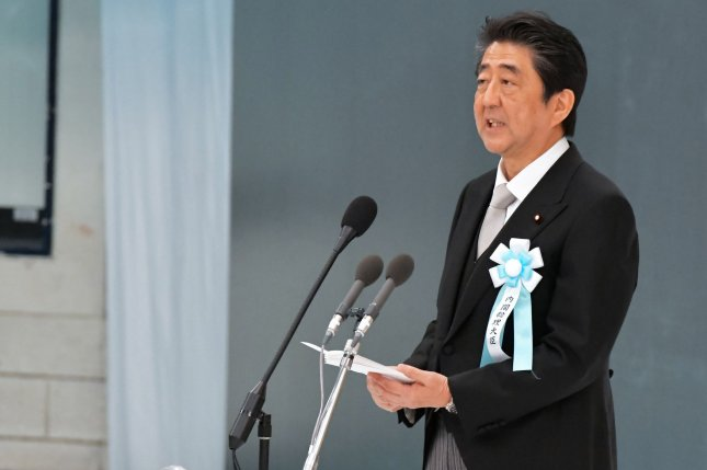 Japan's Prime Minister Shinzo Abe delivers his speech during the memorial service for the war dead of World War II marking the 73rd anniversary of the Japanese surrender at Nippon Budokan in Tokyo on Wednesday. Photo by Keizo Mori/UPI