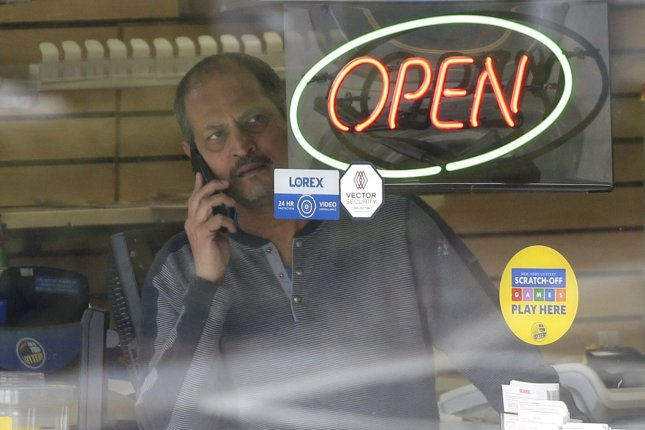 A man looks out of the window while he talks on his cellphone while standing in a local business in New Rochelle, N.Y. on March 11 after a coronavirus outbreak there. Photo by John Angelillo/UPI