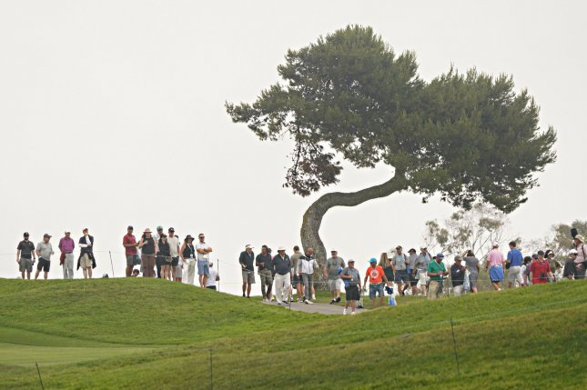 Spectators watch the second round of play on a foggy morning at the 121st U.S. Open Championship at Torrey Pines Golf Course in San Diego, Calif., on Friday, June 18, 2021. Photo by Richard Ellis/UPI