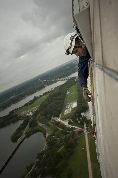 Dan Gach works at the top of the Washington Monument, Sept. 28, 2011, in Washington. UPI/NPS.
