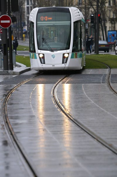 A new tramway runs along Paris' southern belt on December 16, 2006, on its inaugural journey. Seventy years after the last streetcar vanished from the streets of the capital, the tramway, increasingly touted as a clean, fast mass transport solution, made its big comeback today. (UPI Photo/Eco Clement/File)