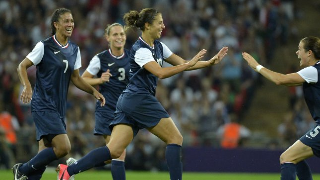 United States' Carli Lloyd (C) jubilates with teammates Kelley O'Hara (R) and Shannon Boxx (L) and Christie Rampone after scoring her second goal of the game, as the US team went on to a 2-1 win over Japan for the Women's Soccer gold medal at Wembley Stadium at the 2012 Summer Olympics, August 9, 2012, in London, England. UPI/Mike Theiler