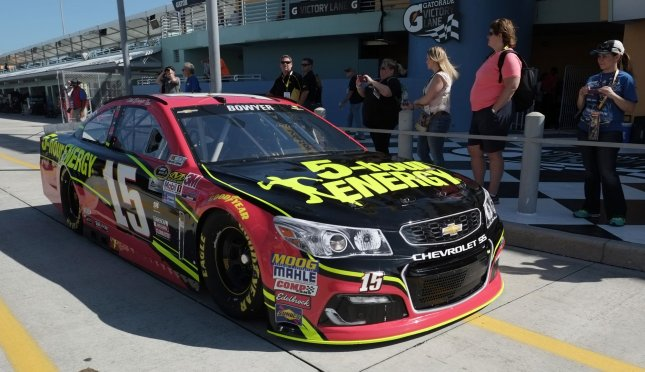 Clint Bowyer leaves the garage area at the Homestead-Miami Speedway in Homestead, Fla. Photo By Gary I Rothstein/UPI