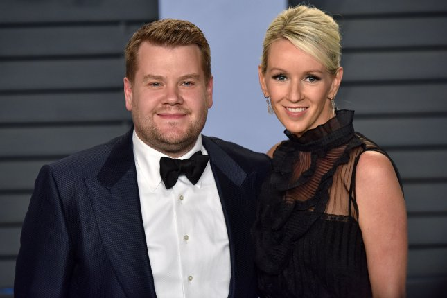 James Corden (L) and his wife Julia Carey. Corden said he stole a candle from Mariah Carey during a round of Spill Your Guts or Fill Your Guts alongside Drew Barrymore and John Boyega. File Photo by Christine Chew/UPI